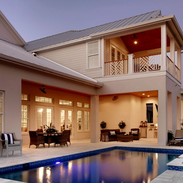 Outdoor Kitchen and Pool Area At Key West Two Story By Custom Home Builder Camlin Custom Homes