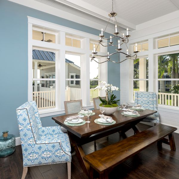 Dining room At Riverfront Low Country By Custom Home Builder Camlin Custom Homes